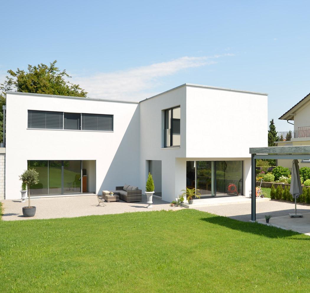Neubau Einfamilienhaus Flachdach: Medici Architekten